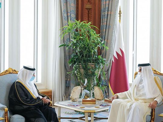 Qatari Emir Tamim Bin Hamad (right) meets the new Saudi ambassador to Doha.