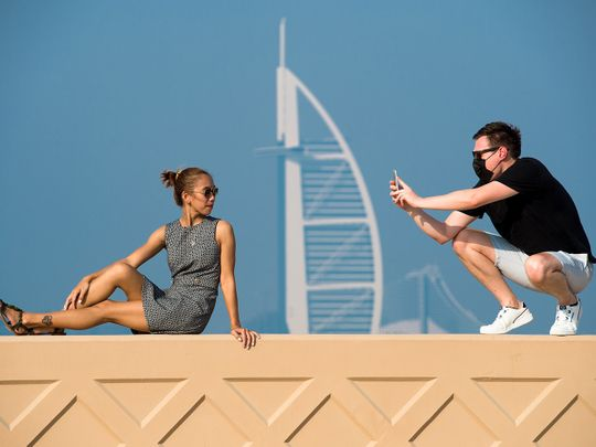 Stock Dubai skyline tourists