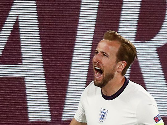 England's forward Harry Kane celebrates scoring the team's first goal during the quarter-final against Ukraine