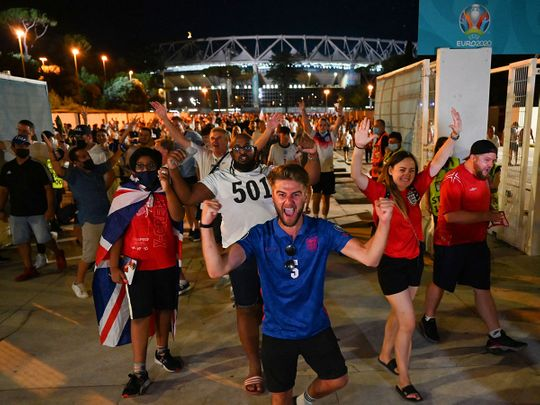 England fans celebrate outside the Stadio Olimpico after defeating Ukraine in Rome