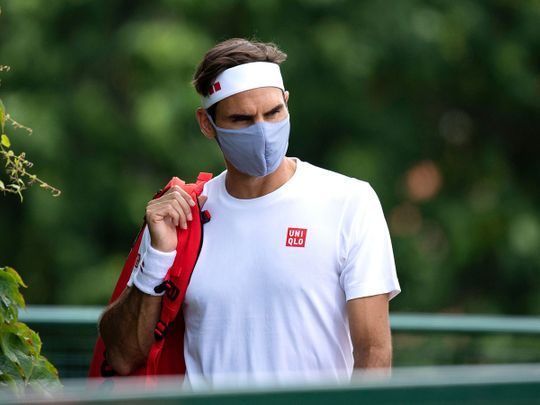 Switzerland's Roger Federer leaves a practice session at Wimbledon