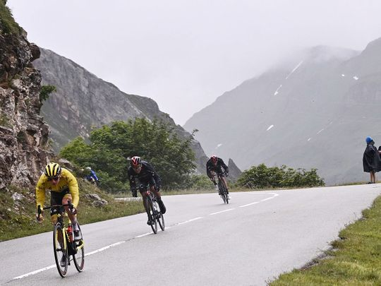 UAE Team Emirates' Tadej Pogacar wearing the Tour de France leader's yellow jersey in the Alps