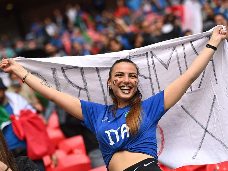 An Italy fan cheers before the start of the UEFA EURO 2020 semi-final football match between Italy and Spain at Wembley Stadium in London on July 6, 2021.