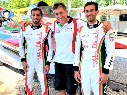 Team Abu Dhabi's Rashed Al Qemzi and Mansoor Al Mansoori with team manager Guido Cappellini.