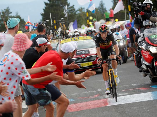 Team Jumbo–Visma rider Wout van Aert crosses the finish line to win stage 11 of the Tour de France