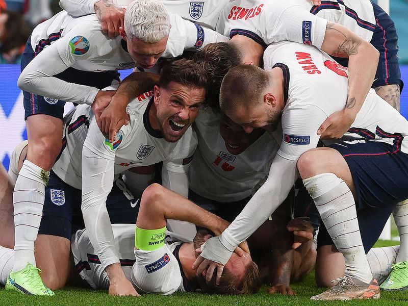England celebrate Harry Kane's winner against Denmark