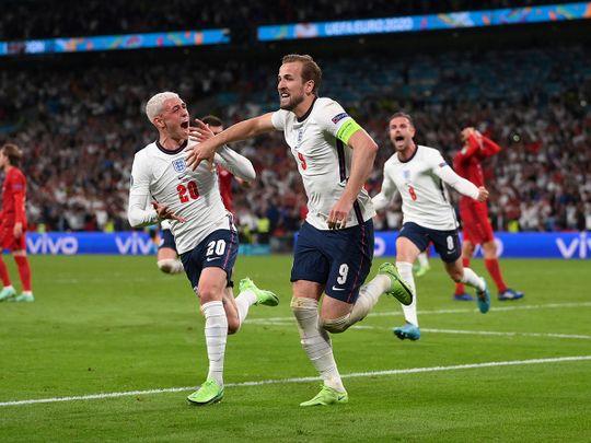 England's Harry Kane celebrates scoring against Denmark with Phil Foden.