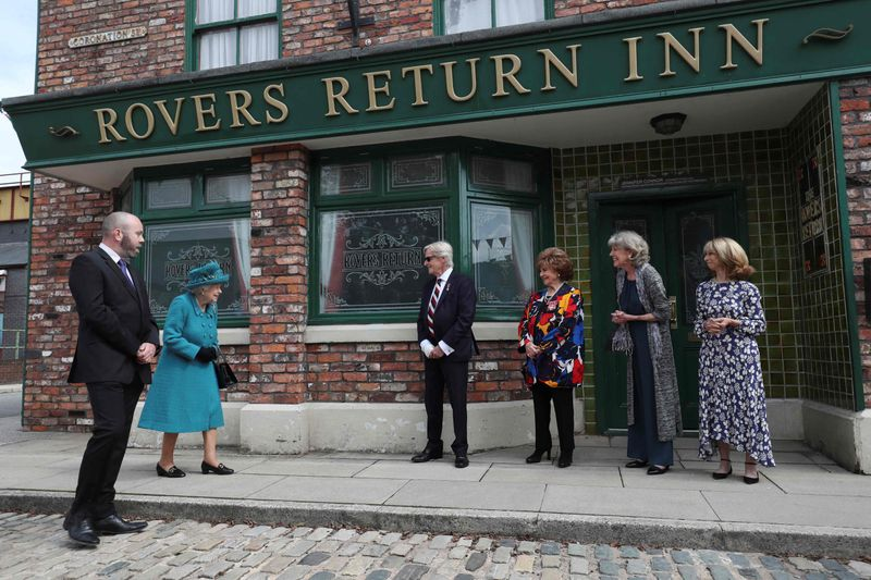 Britain's Queen Elizabeth II meets actors (L-R) William Roache, Barbara Knox, Sue Nicholls and Helen Worth as she visits the set of the long running television series Coronation Street in Manchester, northwest England on July 8, 2021.