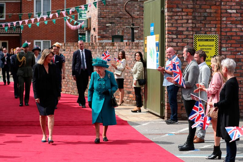 Britain's Queen Elizabeth II visits the set of the long running television series Coronation Street in Manchester, northwest England on July 8, 2021.