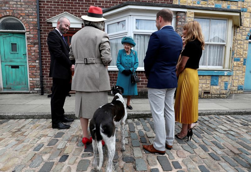 Britain's Queen Elizabeth meets actors and members of the production team during a visit to the set of the long running television series 'Coronation Street', in Manchester, Britain, July 8, 2021.