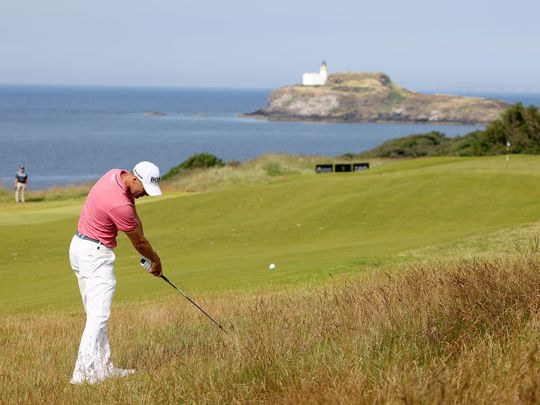 Germany's Martin Kaymer plays a shot from the rough