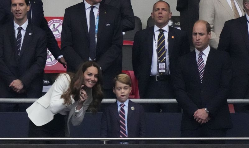 Britain's Catherine (L), Duchess of Cambridge, Prince George of Cambridge (C), and Britain's Prince William (R), Duke of Cambridge, are seen during the UEFA EURO 2020 final football match between Italy and England at the Wembley Stadium in London on July 11, 2021.