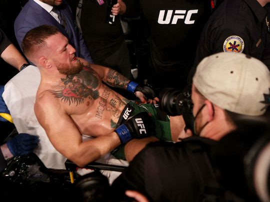 Conor McGregor is carried out of the UFC arena in Las Vegas after breaking his leg against Dustin Poirier