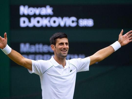 Novak Djokovic celebrates after defeating Italy's Matteo Berrettini to claim the Wimbledon title