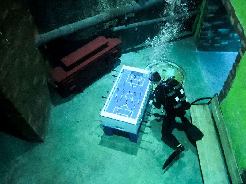 A diver experiences Deep Dive Dubai