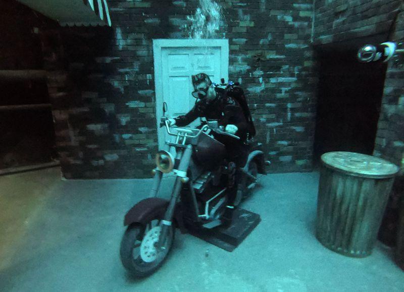 A diver rides a mock bike