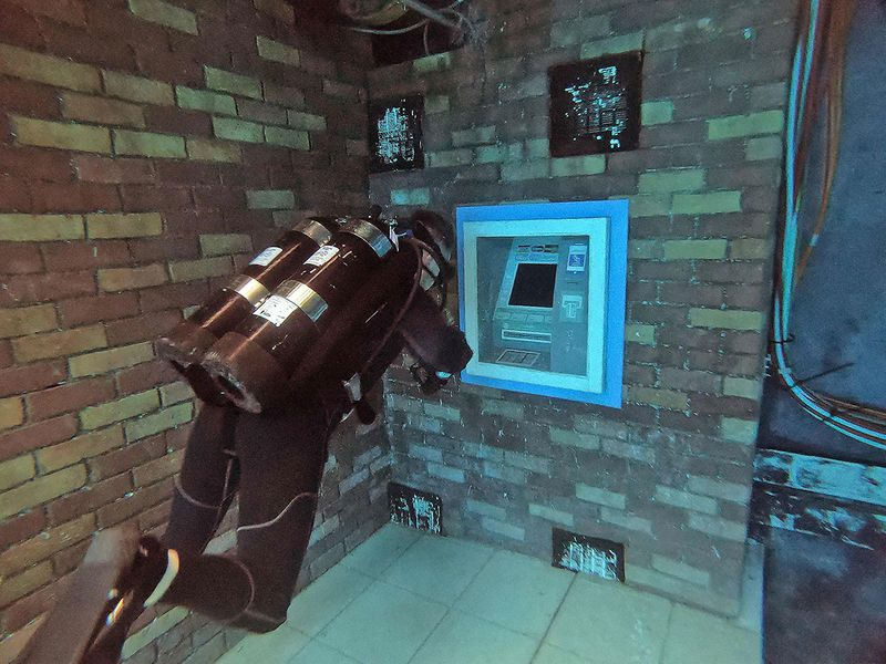 A diver rides a mock bike as he experiences Deep Dive Dubai, the deepest swimming pool in the world reaching 60m, in the United Arab Emirates, on July 10, 2021. -