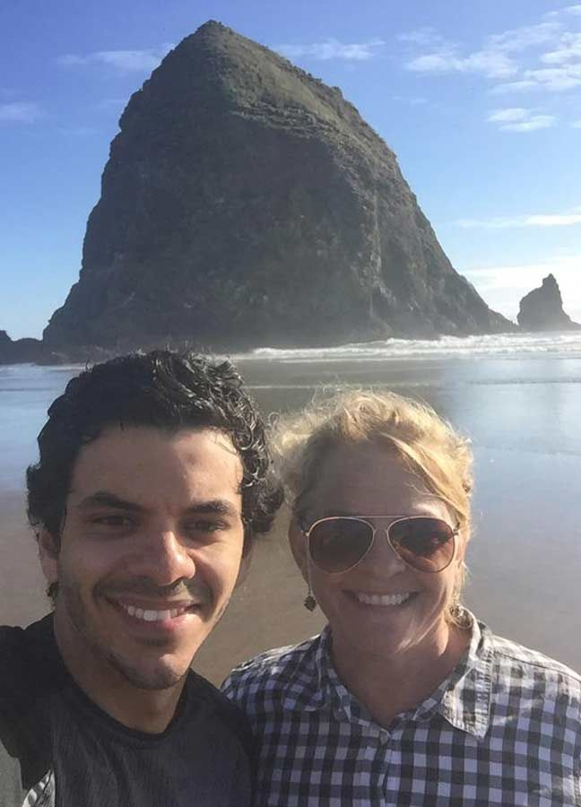 Aziz with his mother at the  Cannon beach in Oregon, USA during a family summer trip