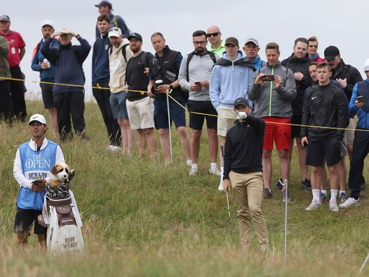 Fans watch Rory McIlroy during a practice round for the Open at Royal St George's