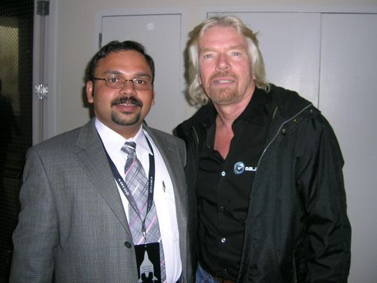 Santhosh George Kulangara (left) with Richard Branson, the founder of the Virgin Group.
