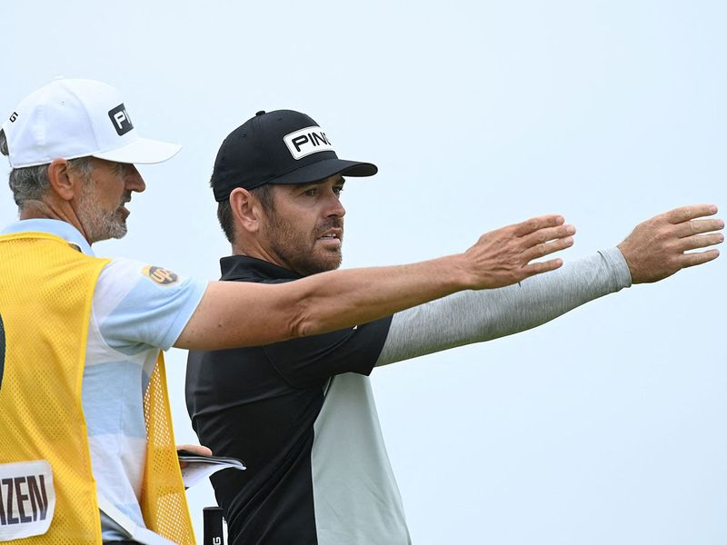 South Africa's Louis Oosthuizen speaks with caddie Colin Byrne during his first round The 149th British Open