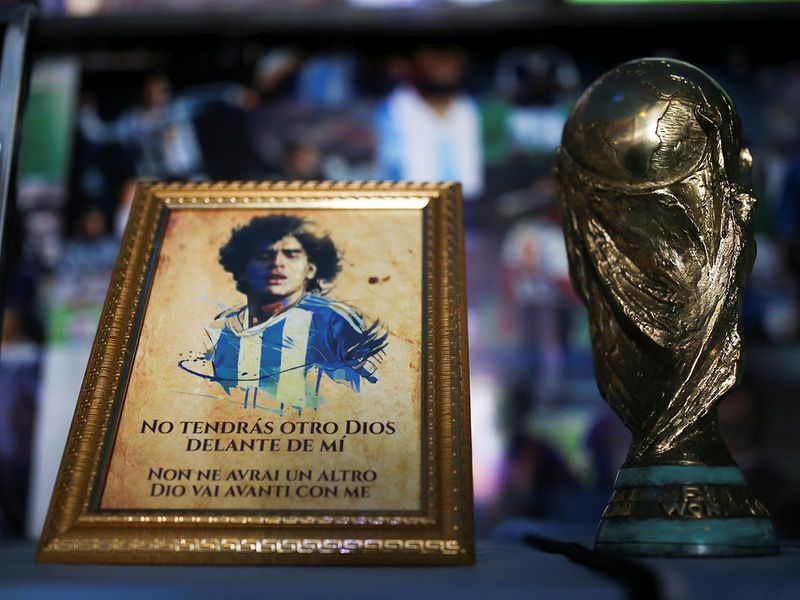 A picture of Diego Maradona and a replica of the World Cup trophy are pictured on an altar at the first Mexico's church in memory of Maradona in San Andres Cholula, in Puebla state.