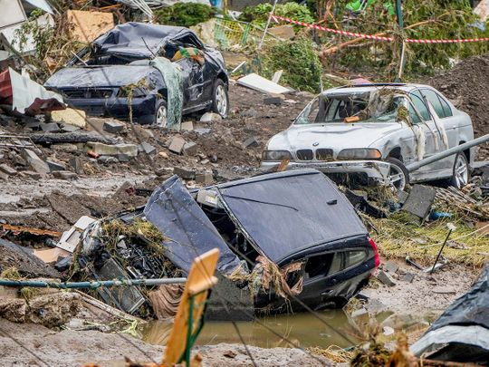 Damaged cars lie on the banks of the Ahr river in Schuld, Germany.