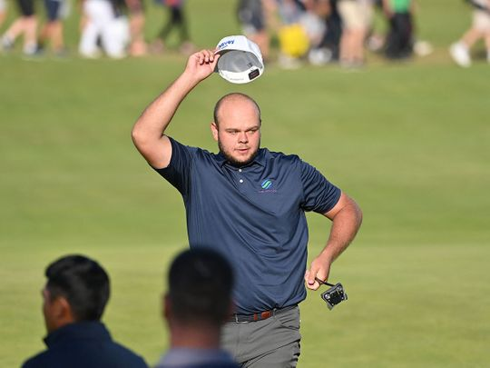 England's Jonathan Thomson waves to fans at The Open