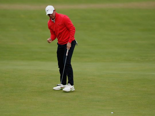 Northern Ireland's Rory McIlroy celebrates after a birdie on the 18th hole during the first round of The Open