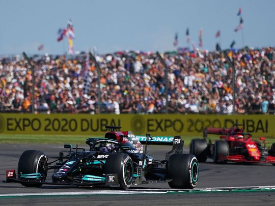 Mercedes driver Lewis Hamilton takes the win over of Ferrari's Charles Leclerc a