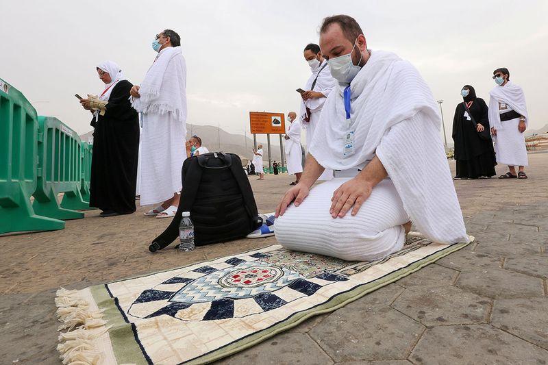 A Muslim pilgrim prays at the plain of Arafat during the annual Haj pilgrimage, outside the holy city of Mecca, Saudi Arabia July 19, 2021