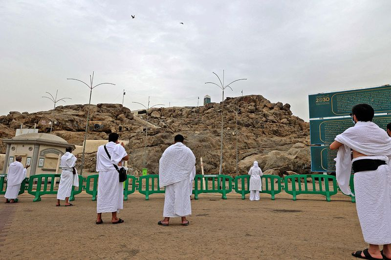 Mulism pilgrims pray on Mount Arafat, also known as Jabal al-Rahma (Mount of Mercy), southeast of the holy city of Mecca, during the climax of the Hajj pilgrimage amid the COVID-19 pandemic,
