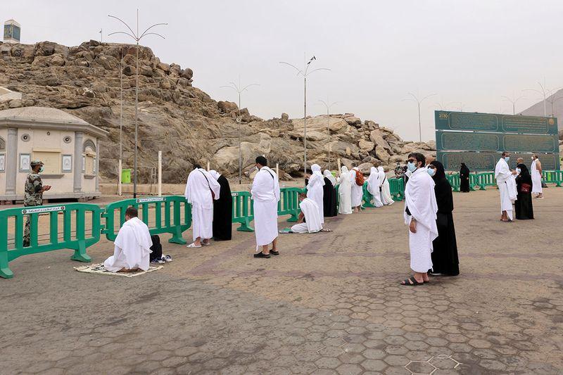 Muslim pilgrims gather at the plain of Arafat during the annual Haj pilgrimage, outside the holy city of Mecca, Saudi Arabia July 19, 2021.