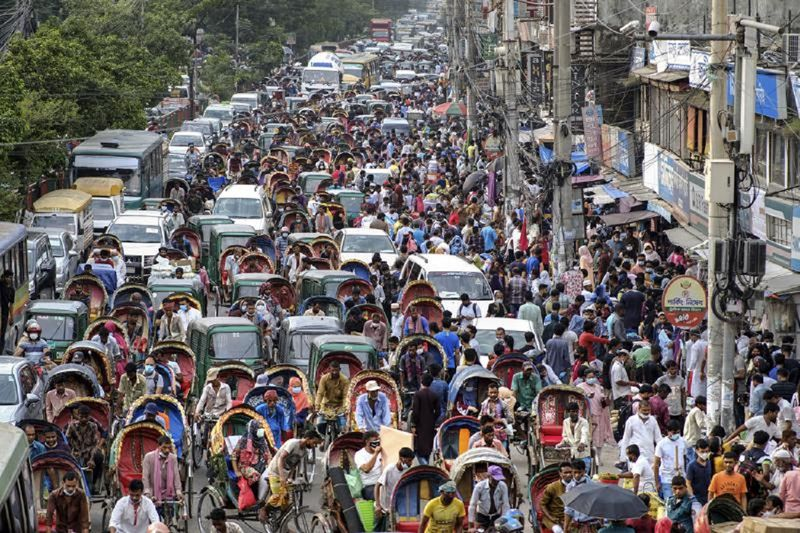 People crowd a market area ahead of Eid-al Adha in Dhaka, Bangladesh, Friday, July 16, 2021. Millions of Bangladeshis are shopping and traveling during a controversial eight-day pause in the country's strict coronavirus lockdown that the government is allowing for the Islamic festival Eid-al Adha. (AP Photo/Mahmud Hossain Opu)