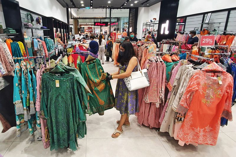 Shoppers buying new cloths for Eid Al Adha shopping at Mirdif City Centre.