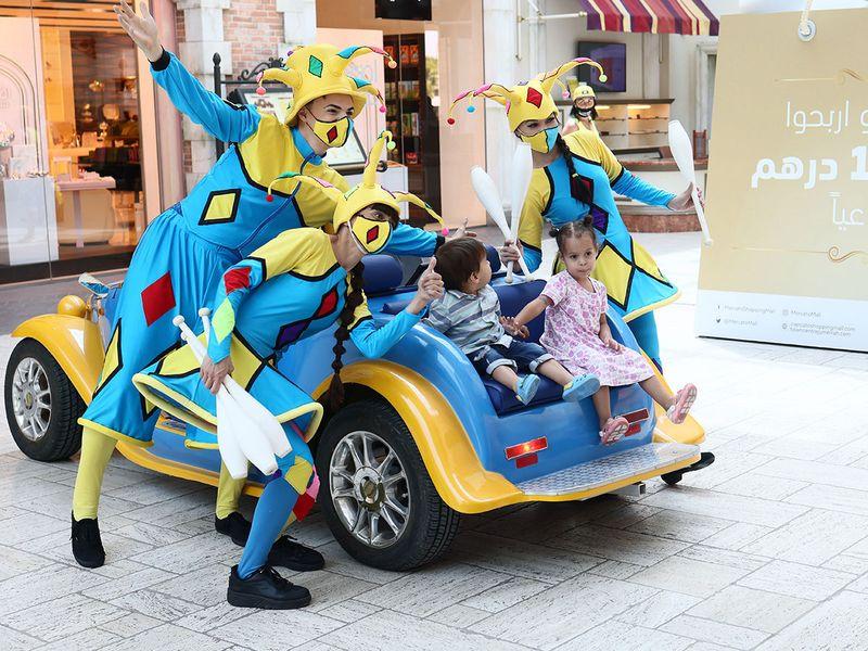 Visitors enjoy the roaming juggling act at the Mercato Mall in Dubai.