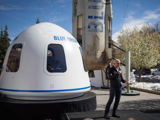 Jeff Bezos in front of Blue Origin's New Shepard system