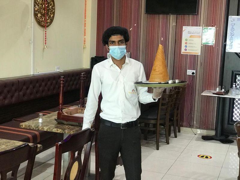 NAT 219718 Eid Workers Girish Devadiga Waiter-1626785982993