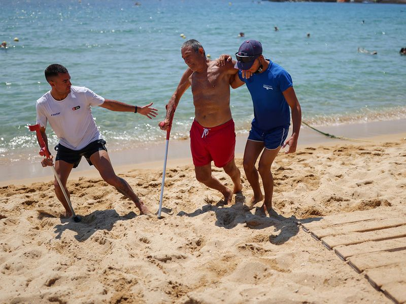 2021-07-20T103748Z_1914320502_RC2LLO99Y9V8_RTRMADP_3_SPAIN-BEACH-DISABLED