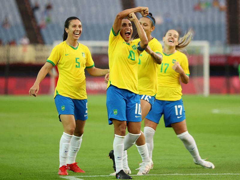 Brazil's Marta celebrates scoring their third goal