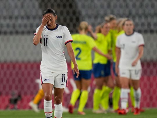 United States' Christen Press reacts as Sweden's players celebrate their third goal at the 2020 Tokyo Olympics