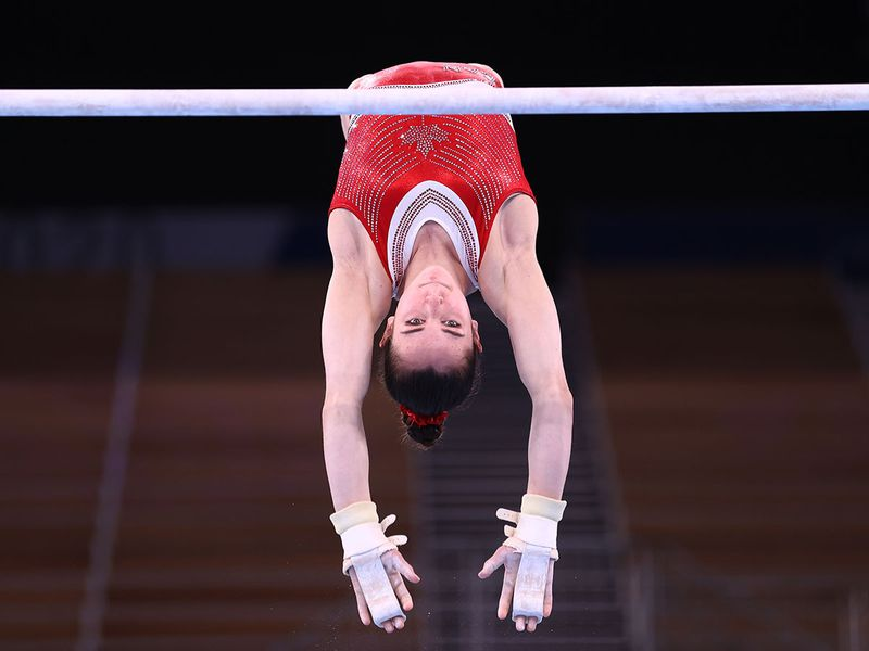 Ava Stewart of Canada on the uneven bars during training