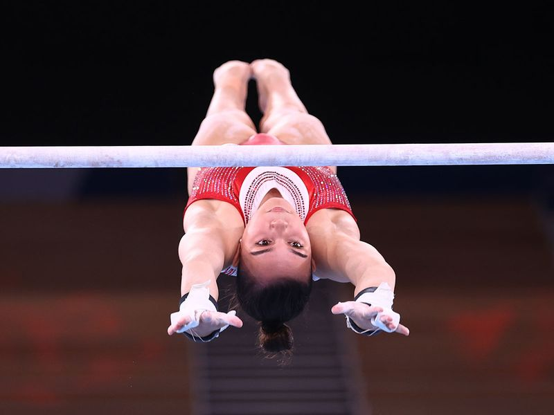 Brooklyn Moors of Canada on the uneven bars during training