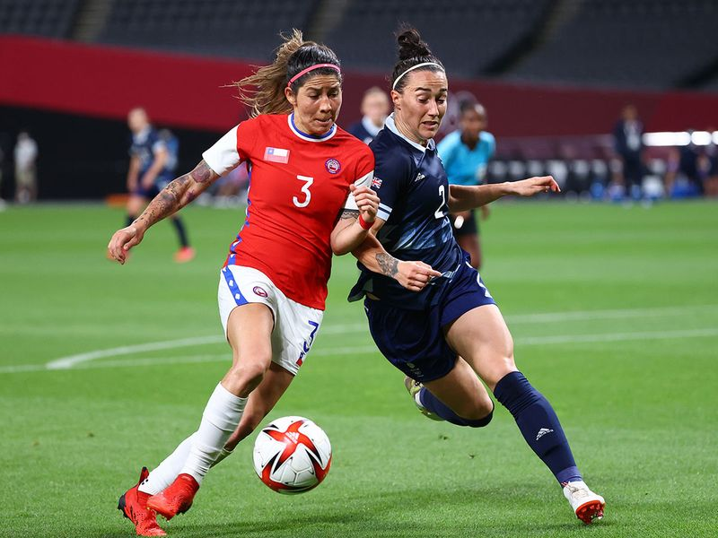 Lucy Bronze of Great Britain in action with Carla Guerrero of Chile
