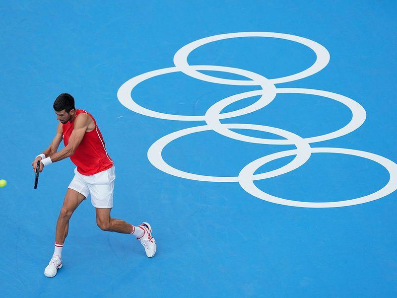 Serbia's Novak Djokovic practises for the men's tennis competition