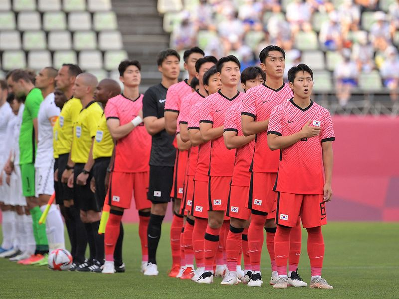 South Korea's players sing the national anthem before the Group B match against New Zealand