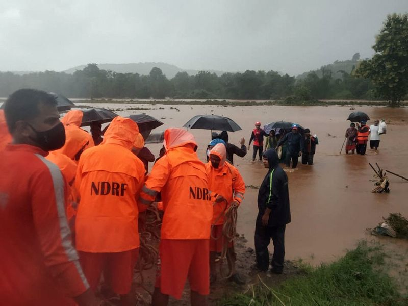 NDRF personnel rescuing stranded villagers