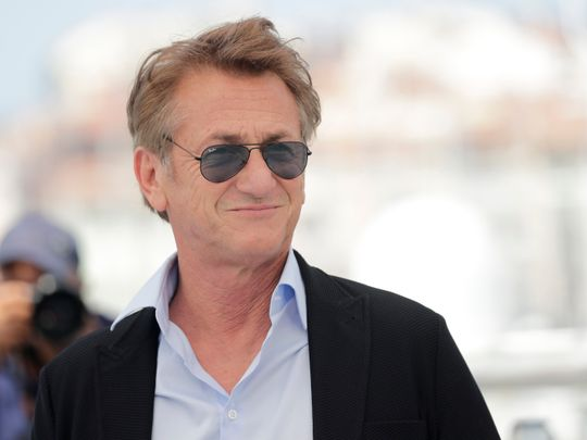 Sean Penn poses for photographers at the photo call for the film 'Flag Day' at the 74th international film festival, Cannes, southern France, Sunday, July 11, 2021.