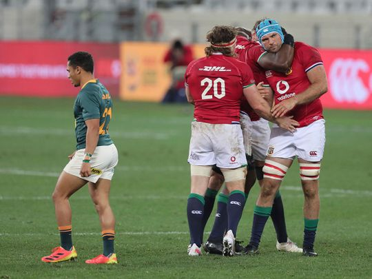 British & Irish Lions' Hamish Watson with teammates Tadhg Beirne and Maro Itoje celebrate after defeating South Africa in the first Test