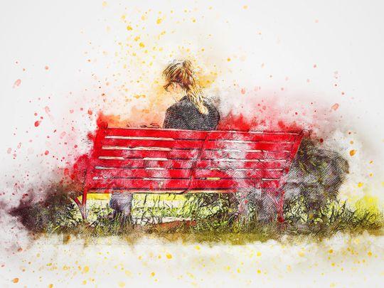 Garden bench woman reading peaceful